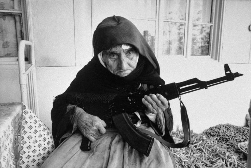 Image of 106 year old Armenian woman protecting her home (1990) courtesy of Historical Times.