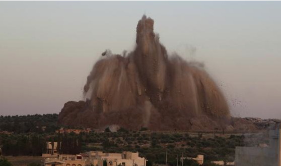 Image of massive tunnel bomb exploding at Syrian army base; courtesy of Reuters (Credit: Khalil Ashawi).